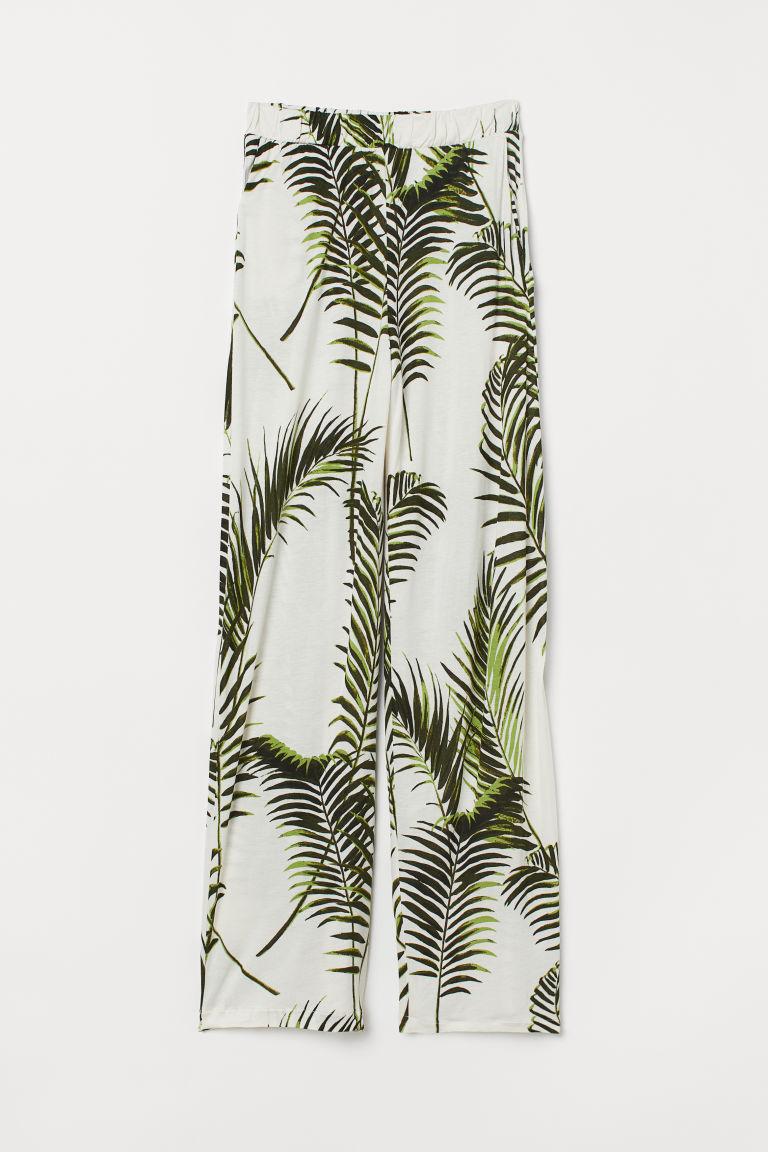 H&M, nohavice so vzorom palmových listov